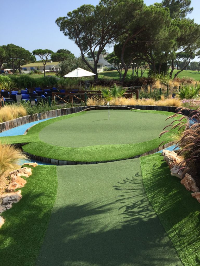 The 17th at the TPC Sawgrass is the inspiration for the last hole at Quinta Mini Golf